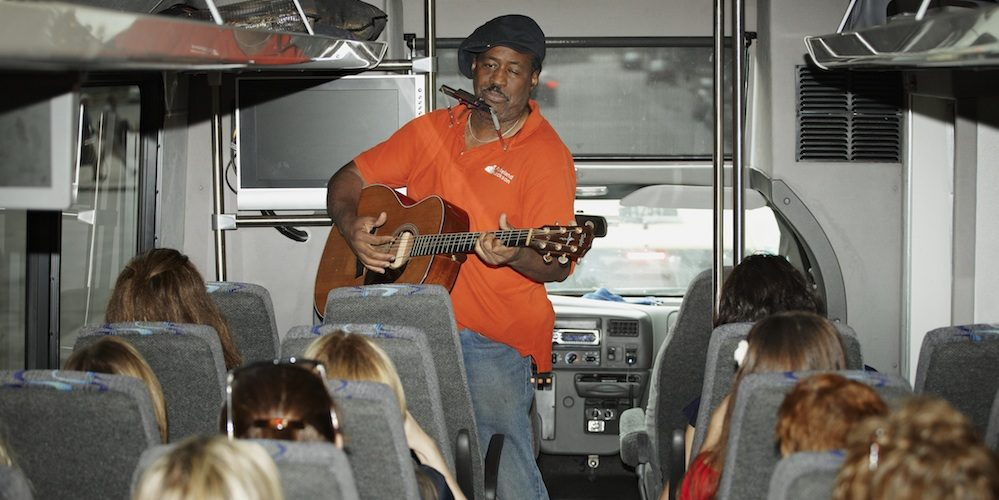 Chicago blues tour with jazz Chicago Detours musician bus student performance group in Chicago