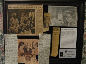 Hull House newspaper clippings bulletin board