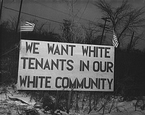 gentrification racial segregation sign