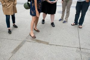 Design Lovers Walking Tour Guests view plaques